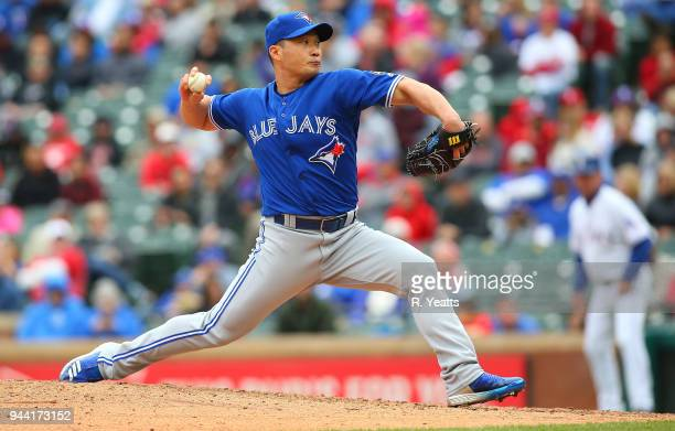 Seung Hwan Oh of the Toronto Blue Jays throws in the eight inning against the Texas Rangers at Globe Life Park in Arlington on April 8 2018 in...