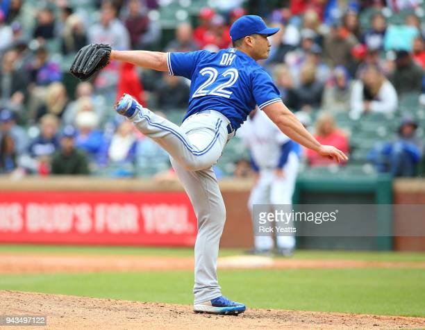 Seung Hwan Oh of the Toronto Blue Jays throws in the eighth inning against the Texas Rangers at Globe Life Park in Arlington on April 8 2018 in...