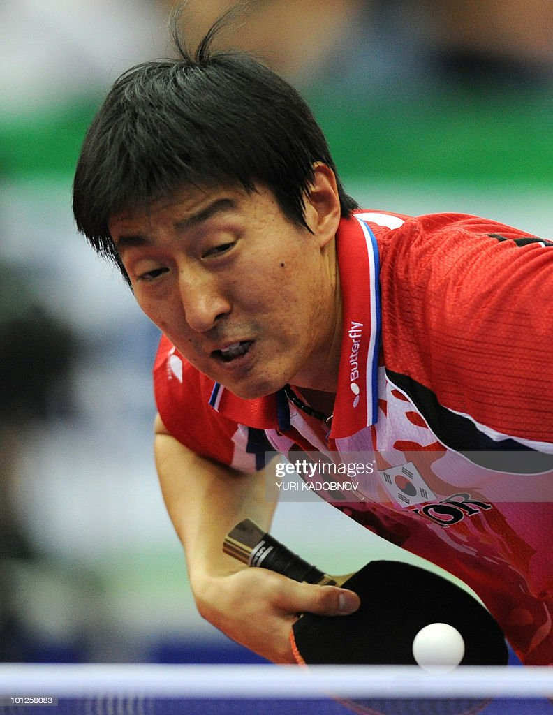 Seung Min Ryu of Korea serves to Dimitrij Ovtcharov of Germany during the men's semi final at the 2010 World Team Table Tennis Championships in Moscow on May 29, 2010.