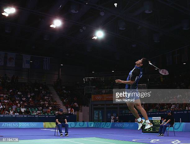 Seung Mo Shon of Korea goes to play a smash shot in his match against Soni Dwi Kuncoro of Indonesia in the men's singles badminton semifinal match on...