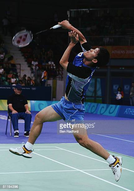 Seung Mo Shon of Korea plays a smash shot during his match against Soni Dwi Kuncoro of Indonesia in the men's singles badminton semifinal match on...