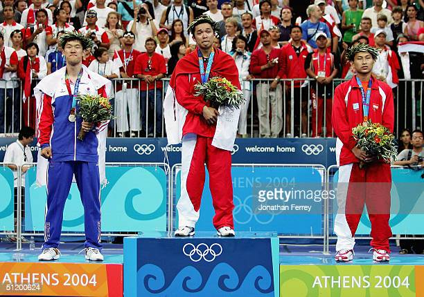 Seung Mo Shon of Korea Taufik Hidayat of Indonesia and Soni Dwi Kuncoro of Indonesia receive medals for the men's singles badminton event on August...