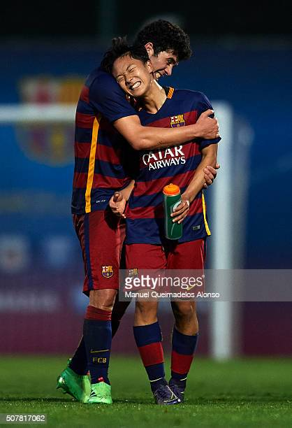 Seung Woo Lee of Barcelona celebrates with his teammate Carles Alena at the end of the match between FC Barcelona U18 and Real Zaragoza U18 at Ciutat...