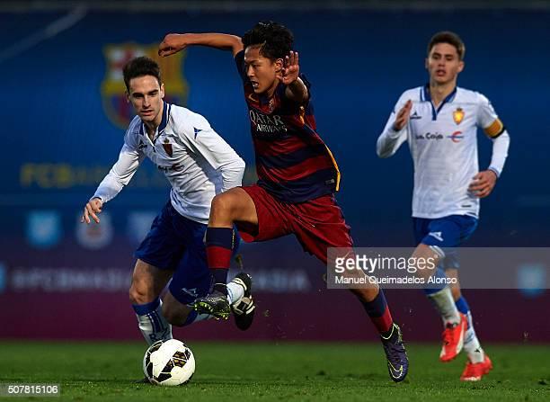 Seung Woo Lee of Barcelona runs with the ball during the match between FC Barcelona U18 and Real Zaragoza U18 at Ciutat Esportiva Joan Gamper on...