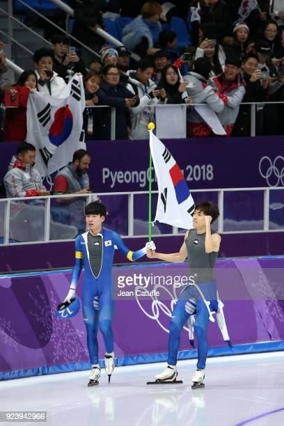 SeungHoon Lee of Korea celebrates his victory with Jaewon Chung of Korea following the Speed Skating Men's Mass Start Final on day fifteen of the...