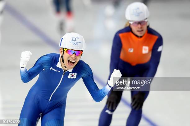 SeungHoon Lee of Korea celebrates winning the gold medal as Koen Verweij of Netherlands takes the bronze during the Men's Speed Skating Mass Start...