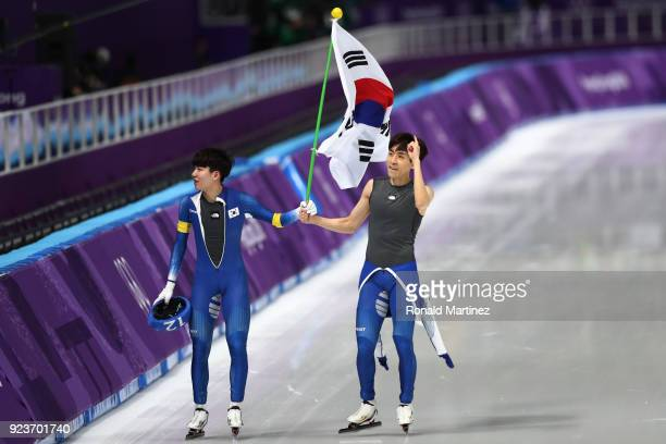 Seung-Hoon Lee of Korea celebrates winning the gold medal with teammate Jaewon Chung of Korea during the Men's Speed Skating Mass Start Final on day...