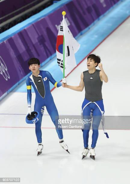 SeungHoon Lee of Korea celebrates winning the gold medal with teammate Jaewon Chung during the Men's Speed Skating Mass Start Final on day 15 of the...