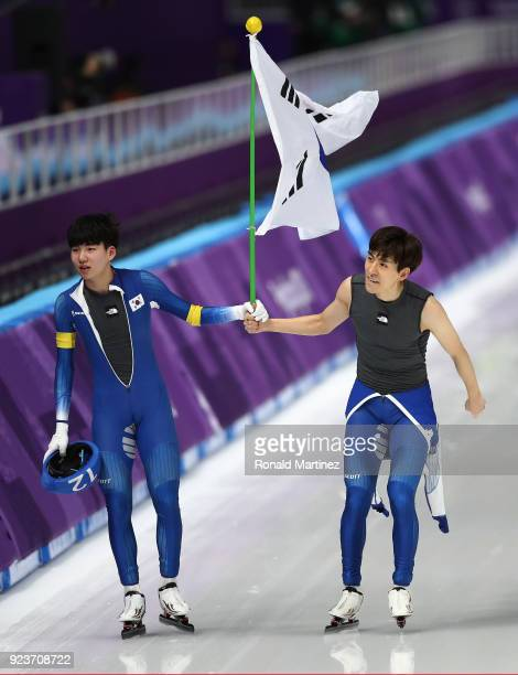 SeungHoon Lee of Korea celebrates winning the gold medal with teammate Jaewon Chung of Korea during the Men's Speed Skating Mass Start Final on day...