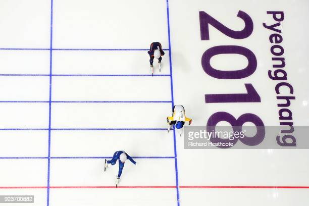 SeungHoon Lee of Korea crosses the finish line ahead of Bart Swings of Belgium and Koen Verweij of Netherlands to win the gold medal during the Men's...