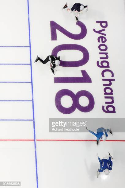 SeungHoon Lee of Korea leads Andrea Giovannini of Italy during the Men's Speed Skating Mass Start Semifinal 1 on day 15 of the PyeongChang 2018...