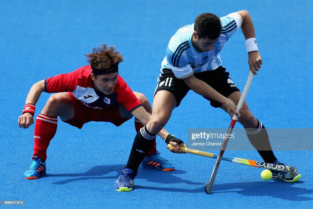 Seunghoon Lee of South Korea tackles Joaquin Menini of Argentina during the Pool A match between Korea and Argentina on day one of Hero Hockey World League Semi-Final at Lee Valley Hockey and Tennis Centre on June 15, 2017 in London, England.