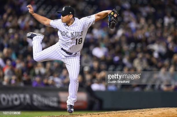 Seunghwan Oh of the Colorado Rockies pitches in the eighth inning of a game against the San Diego Padres at Coors Field on August 21 2018 in Denver...