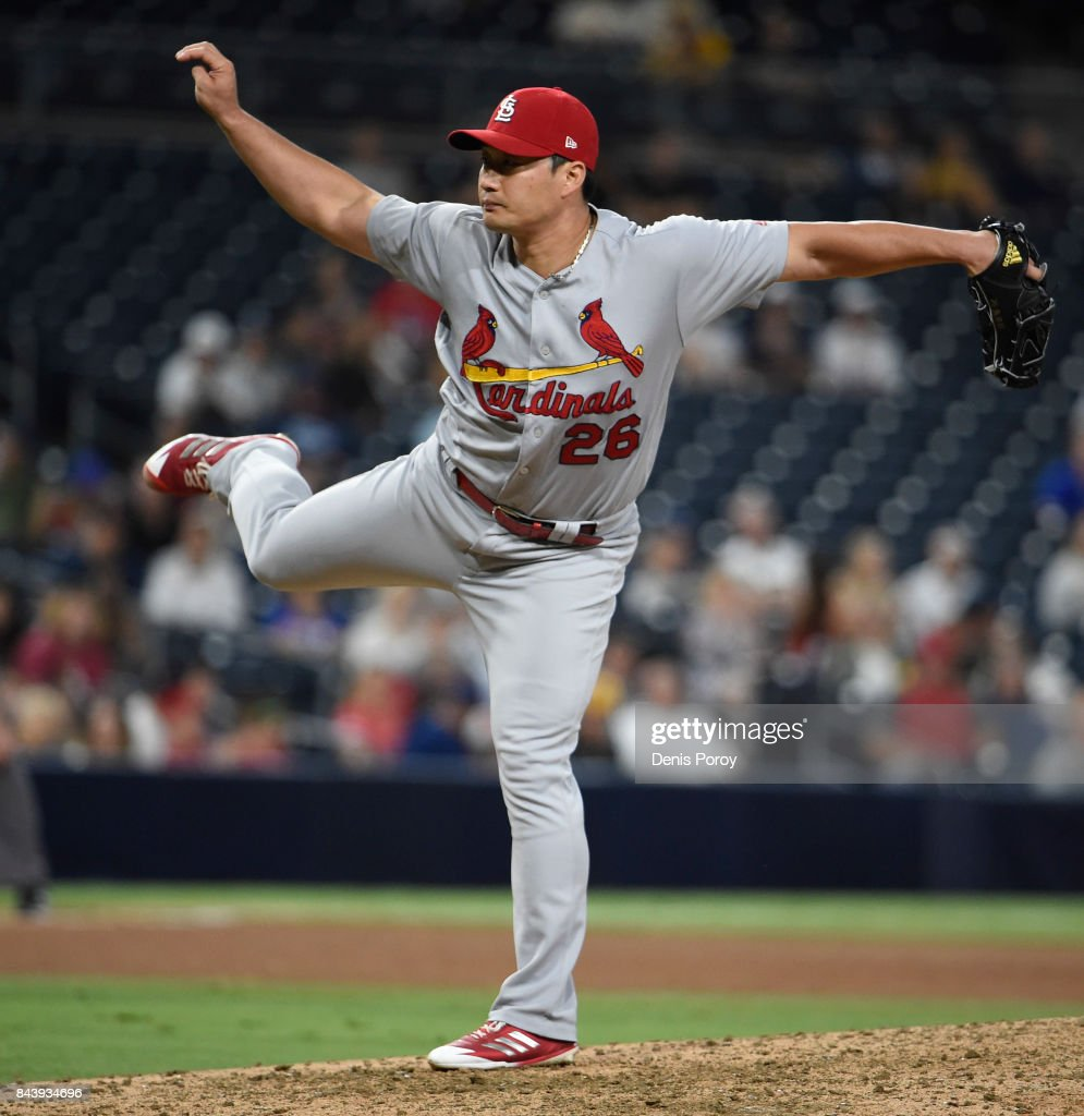 Seung-Hwan Oh #26 of the St. Louis Cardinals pitches during the seventh inning of a baseball game against the San Diego Padres at PETCO Park on September 7, 2017 in San Diego, California.