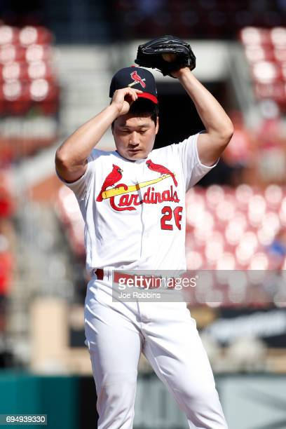 SeungHwan Oh of the St Louis Cardinals reacts after giving up a run scoring single to Howie Kendrick of the Philadelphia Phillies in the ninth inning...