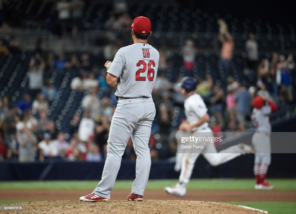 Seung-Hwan Oh #26 of the St. Louis Cardinals stands on the mound after giving up a two-run home run to Wil Myers #4 of the San Diego Padres during the seventh inning of a baseball game against the St. Louis Cardinals at PETCO Park on September 7, 2017 in San Diego, California.