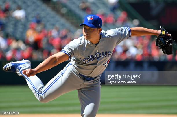 Seunghwan Oh of the Toronto Blue Jays pitches in the game against the Los Angeles Angels of Anaheim at Angel Stadium on June 24 2018 in Anaheim...