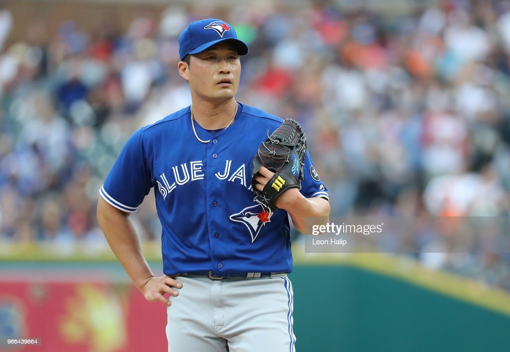 Seunghwan Oh #22 of the Toronto Blue Jays reacts after giving up three runs during the eight inning of the game against the Detroit Tigers at Comerica Park on June 2, 2018 in Detroit, Michigan. The Tigers defeated the Blue Jays 7-4.