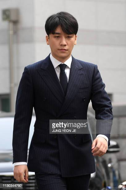 Seungri, a member of the K-pop boy group BIGBANG, arrives for questioning over criminal allegations at the Seoul Metropolitan Police Agency in Seoul...