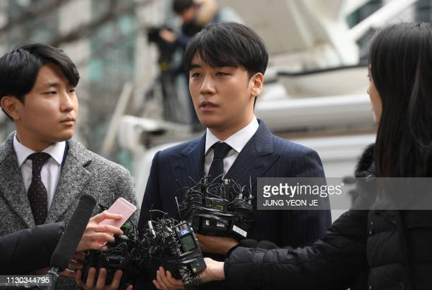 Seungri a member of the Kpop boy group BIGBANG speaks to the media as he arrives for questioning over criminal allegations at the Seoul Metropolitan...