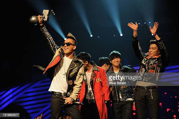 Seungri GDragon Taeyang TOP Daesung of Korean boy band Big Bang accepts their Worldwide Act award onstage during the MTV Europe Music Awards 2011...