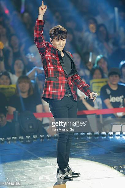 Seungri of South Korean boy band Bigbang performs onstage during the Mnet M CountDown 10th Anniversary on July 24 2014 in Ilsan South Korea