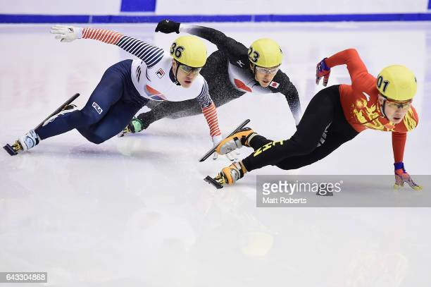 Seungsoo Han of Korea Keita Watanabe of Japan and Ziwei Ren of China competes in the Men's 500 metre Short Track Speed Skating on day four of the...