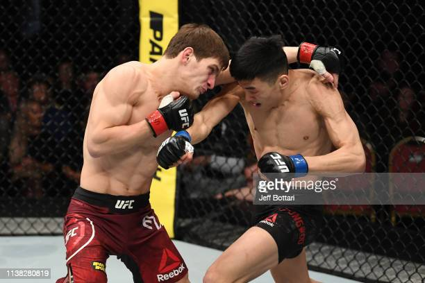 Seungwoo Choi of South Korea and Movsar Evloev of Russia exchange punches in their featherweight bout during the UFC Fight Night event at Yubileyny...
