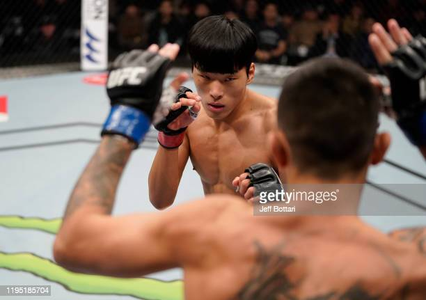 Seungwoo Choi of South Korea battles Suman Mokhtarian of Australia in their featherweight fight during the UFC Fight Night event at Sajik Arena 3 on...