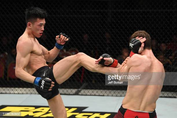 Seungwoo Choi of South Korea kicks Movsar Evloev of Russia in their featherweight bout during the UFC Fight Night event at Yubileyny Sports Palace on...