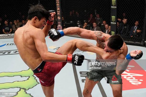Seungwoo Choi of South Korea kicks Suman Mokhtarian of Australia in their featherweight fight during the UFC Fight Night event at Sajik Arena 3 on...