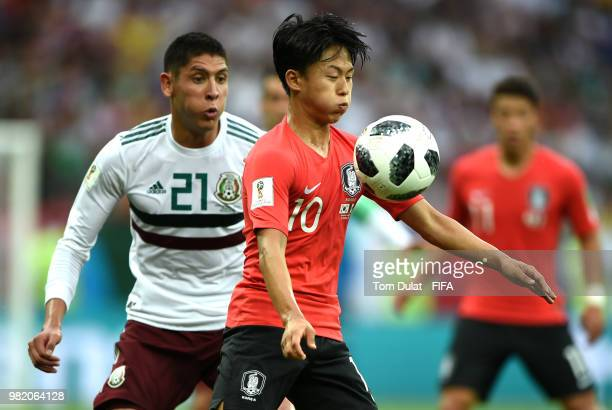 Seungwoo Lee of Korea Republic controls the ball under pressure from Edson Alvarez of Mexico during the 2018 FIFA World Cup Russia group F match...