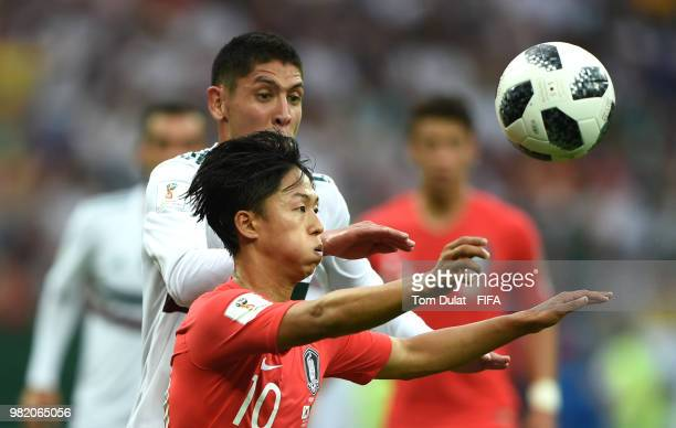 Seungwoo Lee of Korea Republic is challenged by Edson Alvarez of Mexico during the 2018 FIFA World Cup Russia group F match between Korea Republic...