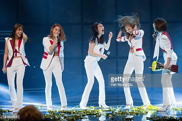 Seungyeon Gyuri Kang JiYoung Hara and Nicole of South Korean girl group Kara perform onstage the MBC Music Show Champion at UniqloAX Hall on...