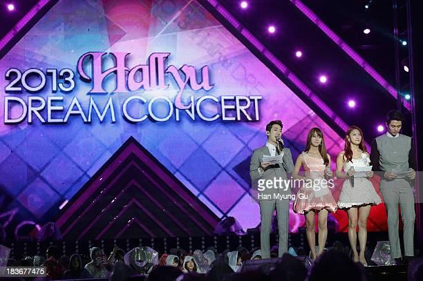Seungyeon Gyuri of South Korean girl group Kara and Jo Kwon Seulong of South Korean boy band 2AM attend the 2013 Hallyu Dream Concert on October 5...