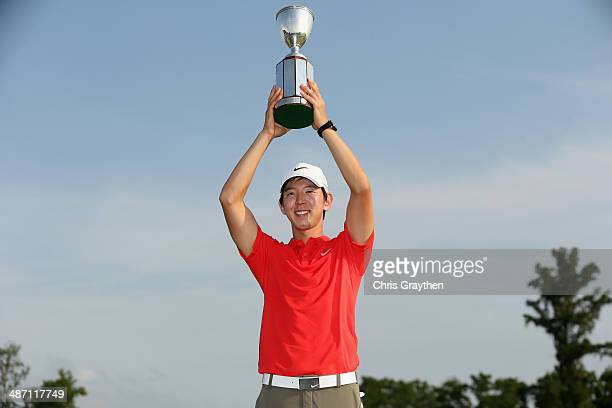 SeungYul Noh celebrates after his win with the Zurich trophy during the Final Round of the Zurich Classic of New Orleans at TPC Louisiana on April 27...