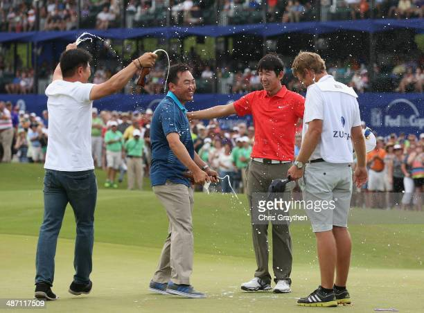 SeungYul Noh celebrates with golfers Charlie Wi and YE Yang and his caddy Scott Saitinac after his win during the Final Round of the Zurich Classic...