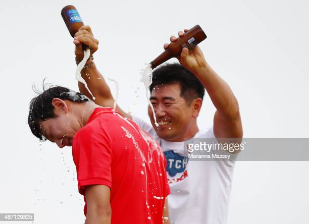 Seung-Yul Noh has beer poured on him by golfer Y.E. Yang after winning the Zurich classic during the final round of the Zurich Classic of New Orleans...