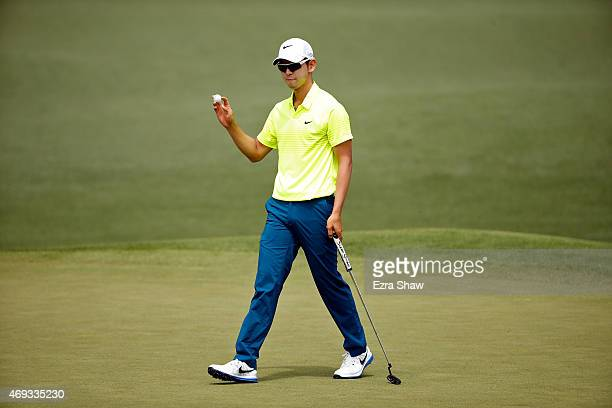 SeungYul Noh of Korea waves to the gallery on the second green during the third round of the 2015 Masters Tournament at Augusta National Golf Club on...