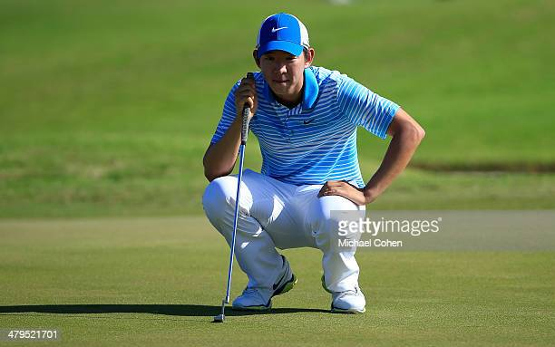 SeungYul Noh of South Korea lines up a putt during the first round of the Puerto Rico Open presented by seepuertoricocom held at Trump International...