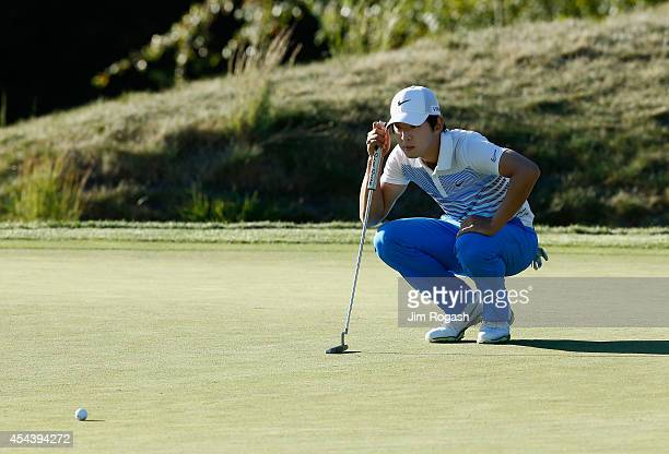SeungYul Noh of South Korea prepares to putt on the eighth hole during the second round of the Deutsche Bank Championship at the TPC Boston on August...