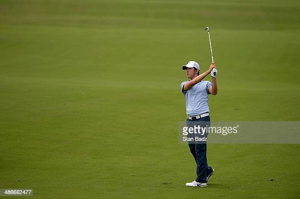 Seung-Yul Noh plays a shot on the 18th during Round Two of the Zurich Classic of New Orleans at TPC Louisiana on April 25, 2014 in Avondale,...