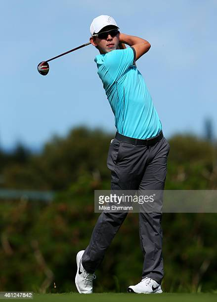 SeungYul Noh plays his shot from the fourth tee during round one of the Hyundai Tournament of Champions at Plantation Course at Kapalua Golf Club on...