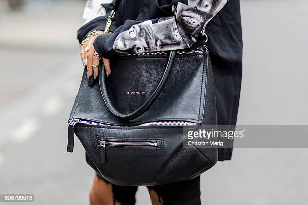 00fee1d5 Sev Halit wearing a HBA longshirt ripped jeans Givenchy bag outside during  London Fashion Week Spring