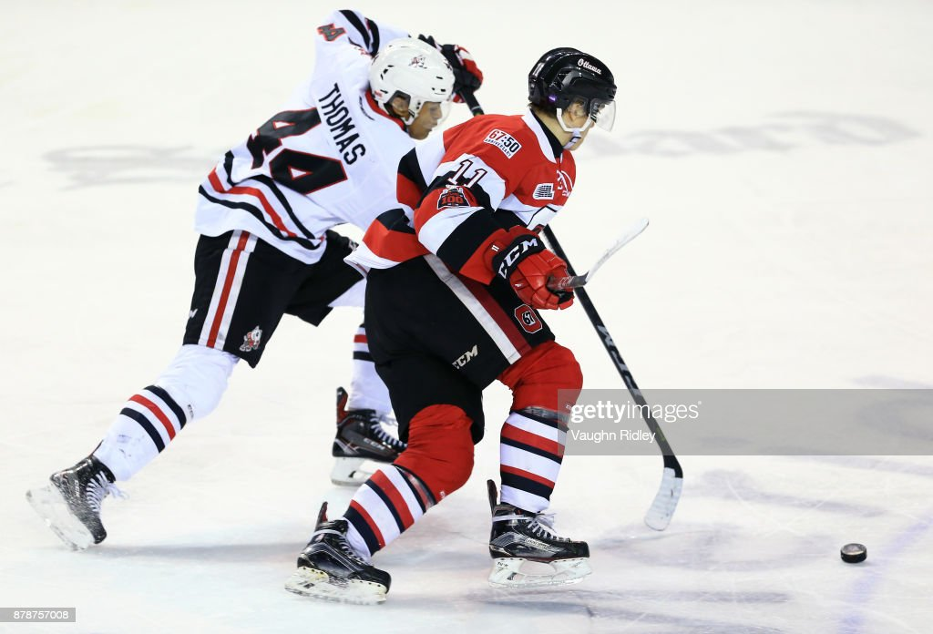 Seva Losev #11 of the Ottawa 67's battles with Akil Thomas #44 of the Niagara IceDogs during the third period of an OHL game at the Meridian Centre on November 24, 2017 in St Catharines, Ontario, Canada.