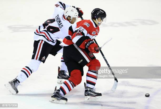 Seva Losev of the Ottawa 67's battles with Akil Thomas of the Niagara IceDogs during the third period of an OHL game at the Meridian Centre on...