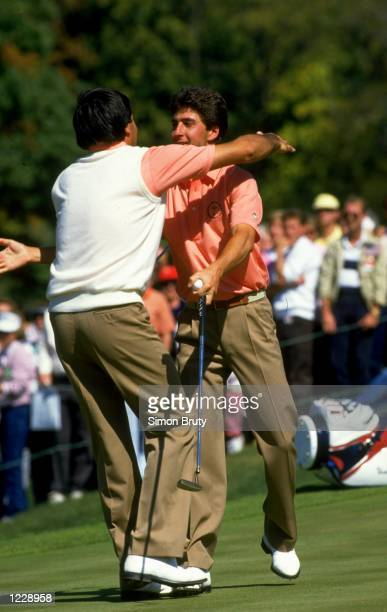 Seve Ballesteros and Jose Maria Olazabal of Europe congratulate each other during the Ryder Cup at Muirfield Village in Ohio USA Europe won the event...