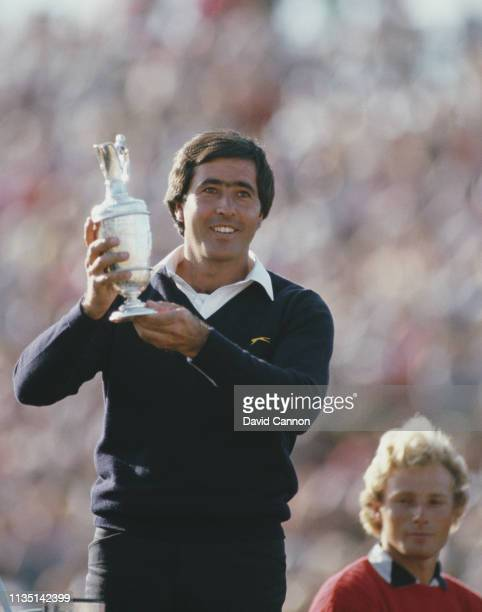 Seve Ballesteros of Spain celebrates with the Claret Jug after he holes out on the final 18th green to win the 113th Open Championship from Bernhard...