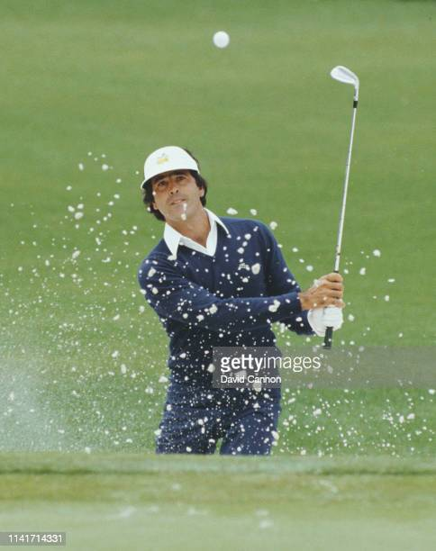 Seve Ballesteros of Spain chips out of a bunker during the final round of the US Masters Golf Tournament on 14th April 1985 at the Augusta National...