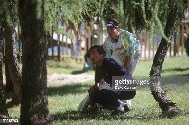 Seve Ballesteros of Spain contemplates his miracle shot on the 18th hole to set up a birdie finish during the final round of the European Masters at...